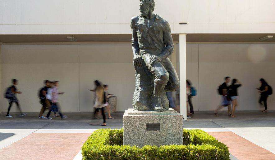 """This Sept. 20, 2017 photo shows  """"Prospector Pete"""" statue at  California State University, Long Beach, Calif.   The school will be ousting its """"Prospector Pete"""" statue because of the impact the 1849 gold rush had on indigenous people. A statement on the university website says the gold rush was """"a time in history when the indigenous peoples of California endured subjugation, violence and threats of genocide.""""  (Thomas R. Cordova/The Orange County Register via AP)"""