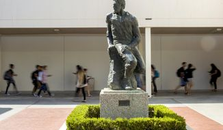 "This Sept. 20, 2017 photo shows  ""Prospector Pete"" statue at  California State University, Long Beach, Calif.   The school will be ousting its ""Prospector Pete"" statue because of the impact the 1849 gold rush had on indigenous people. A statement on the university website says the gold rush was ""a time in history when the indigenous peoples of California endured subjugation, violence and threats of genocide.""  (Thomas R. Cordova/The Orange County Register via AP)"