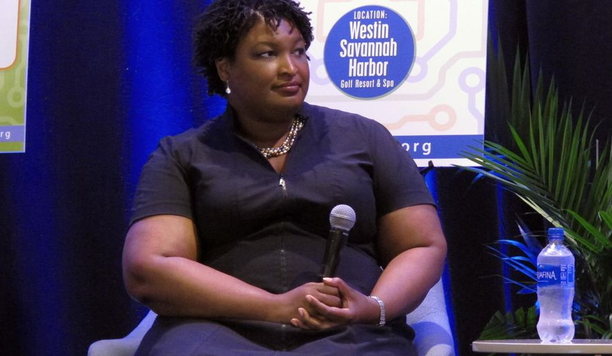 Stacey Abrams, the Democratic nominee for Georgia governor, answers questions Friday, Sept. 21, 2018, during an appearance at a conference of the Georgia Economic Developers Association in Savannah, Ga. Abrams faces Republican Brian Kemp in the general election on Nov. 26, 2018.  (AP Photo/Russ Bynum)