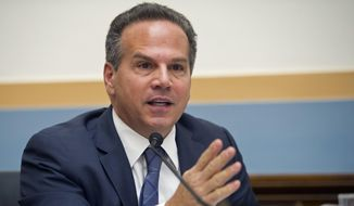 In this Feb. 4, 2014, file photo, U.S. Rep. David Cicilline, D-R.I., is shown asking questions at a Capitol Hill hearing in Washington. (AP Photo/Cliff Owen, File) **FILE**