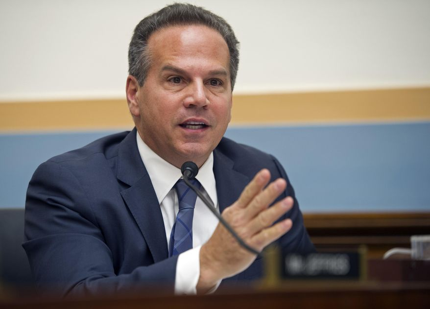 In this Feb. 4, 2014, file photo, U.S. Rep. David Cicilline, D-R.I., questions Deputy Attorney General James Cole as he testifies before the House Judiciary Committee hearing on Examining Recommendations to Reform FISA Authorities, on Capitol Hill in Washington. (AP Photo/Cliff Owen, File)
