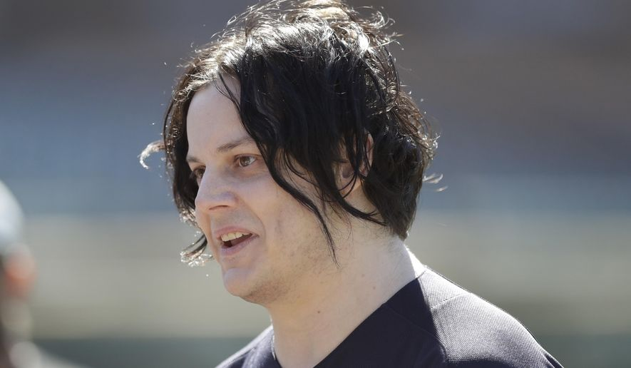 """FILE - In this April 8, 2017 file photo, musician Jack White is seen before batting practice of a baseball game between the Detroit Tigers and the Boston Red Sox, in Detroit. Grammy winner White is helping preserve a piece of 1980s movie history. The singer's management confirmed Friday, Sept. 21, 2018, he donated $30,000 to help restore a house in Tulsa, Oklahoma, and featured in 1983's """"The Outsiders."""" Danny O'Connor is leading an effort to turn the house into a museum about the coming-of-age drama and book of the same name. O'Connor tells reporters White helped meet a $75,000 fundraising goal. (AP Photo/Carlos Osorio)"""