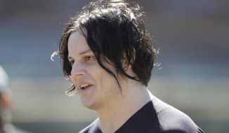 "FILE - In this April 8, 2017 file photo, musician Jack White is seen before batting practice of a baseball game between the Detroit Tigers and the Boston Red Sox, in Detroit. Grammy winner White is helping preserve a piece of 1980s movie history. The singer's management confirmed Friday, Sept. 21, 2018, he donated $30,000 to help restore a house in Tulsa, Oklahoma, and featured in 1983's ""The Outsiders."" Danny O'Connor is leading an effort to turn the house into a museum about the coming-of-age drama and book of the same name. O'Connor tells reporters White helped meet a $75,000 fundraising goal. (AP Photo/Carlos Osorio)"