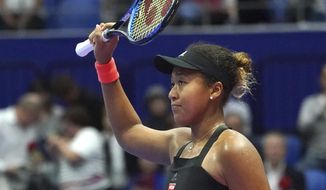 Naomi Osaka of Japan celebrates after defeating Barbora Strycova of the Czech Republic after the quarterfinal match of the Pan Pacific Open women's tennis tournament in Tokyo Friday, Sept. 21, 2018. (AP Photo/Eugene Hoshiko)