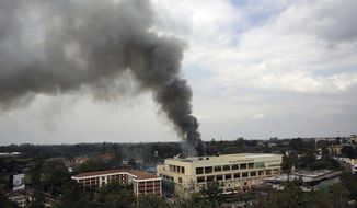 FILE - In this Monday, Sept. 23, 2013, file photo, heavy smoke rises from the Westgate Mall after large blasts rocked the building on the third day of a hostage siege in Nairobi, Kenya. Five years after al-Shabab fighters burst into the luxury shopping mall hurling grenades and starting a days-long siege that left 67 people dead, analysts say the Somalia-based extremist group has been pushed down Africa's east coast as far as Mozambique as its regional threat expands. (AP Photo/Jerome Delay, File)