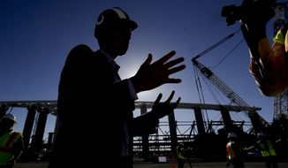 Los Angeles Rams, COO, Kevin Demoff talks with reporters at the LA Stadium construction site on Tuesday, Sept. 18, 2018, in Inglewood, Calif. The new facility for the Los Angeles Rams and Los Angeles Chargers is tentatively scheduled to be competed for the 2020 NFL football season. (AP Photo/Chris Carlson)