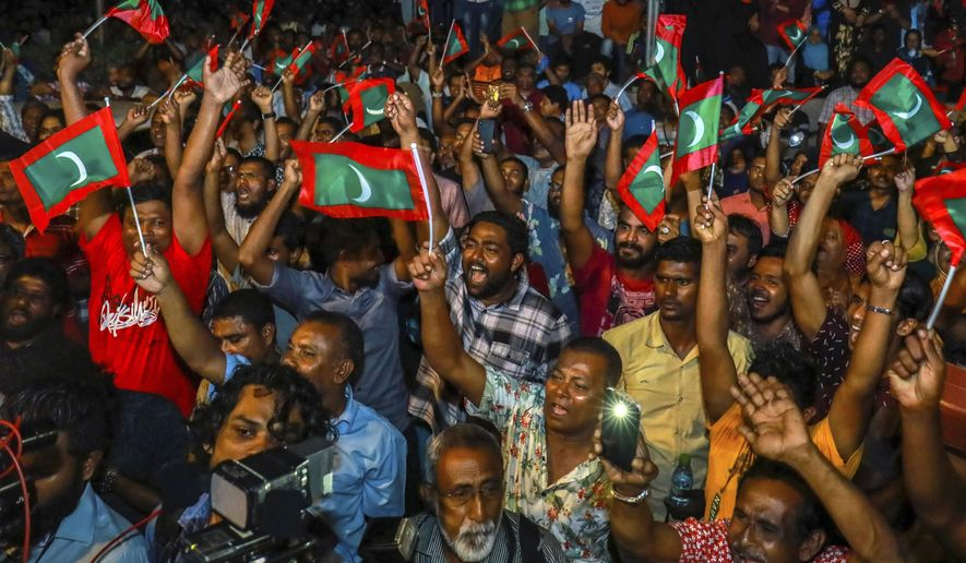FILE - In this Feb. 2, 2018, file photo, Maldivian opposition protestors shout slogans demanding the release of political prisoners during a protest in Male, Maldives. Supporters of political parties that oppose the Maldives government have clashed with police on the streets of the capital after the country's supreme court ordered the release of imprisoned politicians.(AP Photo/Mohamed Sharuhaan, File)