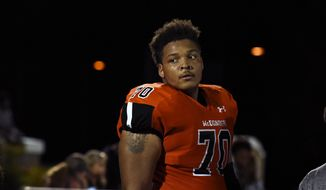 In this Sept. 16, 2016, file photo, McDonogh high school football lineman Jordan McNair watches from the sideline during a game in McDonogh, Md. An independent investigation into the death of University of Maryland football player Jordan McNair has determined that trainers on the scene did not follow proper procedures after he collapsed on the field. McNair was hospitalized on May 29 after a team workout and died June 13. The family attorney said the cause of death was heatstroke. (Barbara Haddock Taylor/The Baltimore Sun via AP) **FILE**