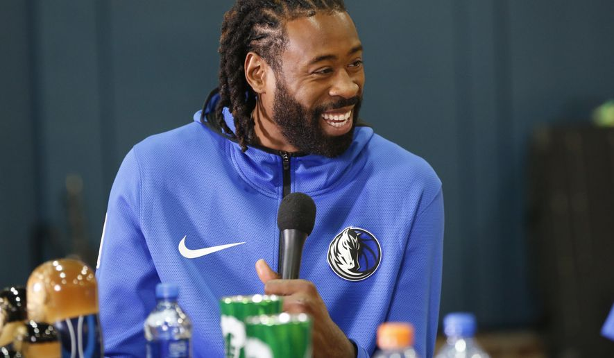 Newly acquired Dallas Mavericks center DeAndre Jordan speaks to the media during the NBA basketball team's media day in Dallas, Friday, Sept. 21, 2018. (AP Photo/Jim Cowsert)