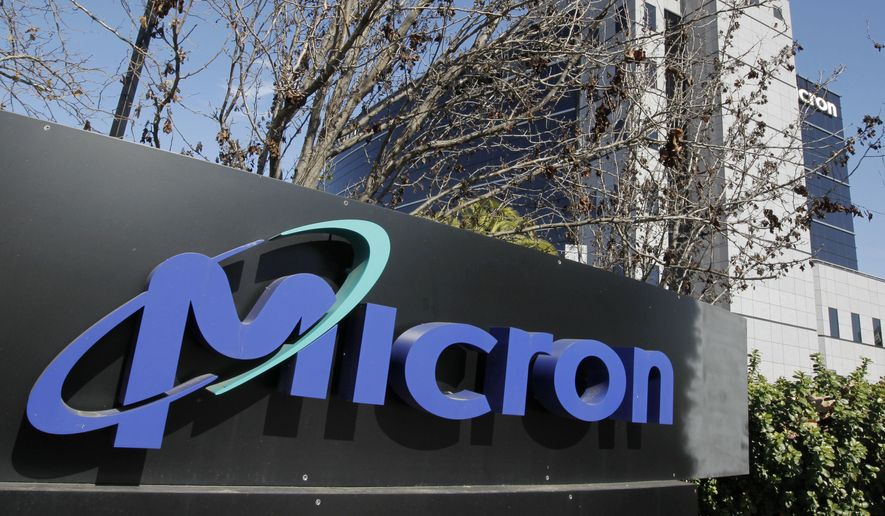 This Feb. 3, 2012, file photo shows the exterior view of memory chip maker Micron offices in San Jose, Calif. (AP Photo/Paul Sakuma, File)