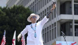 """In this June 30, 2018 file photo, Taboo from Black Eyed Peas performs """"Where is the Love?"""" at the """"Families Belong Together: Freedom for Immigrants"""" March in Los Angeles. The Black Eyed Peas tackle gun violence at schools and immigration in two new music videos for their song, """"Big Love."""" The trio released the videos Friday, Sept. 21, 2018 (Photo by Willy Sanjuan/Invision/AP, File)"""