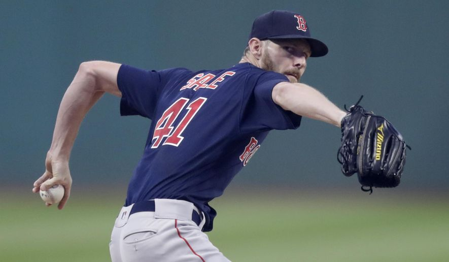 Boston Red Sox starting pitcher Chris Sale delivers in the first inning of the team's baseball game against the Cleveland Indians, Friday, Sept. 21, 2018, in Cleveland. (AP Photo/Tony Dejak)