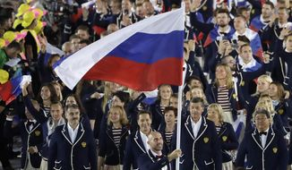 """FILE - In this Aug. 5, 2016, file photo, Sergei Tetiukhin carries the flag of Russia during the opening ceremony for the 2016 Summer Olympics in Rio de Janeiro, Brazil. The World Anti-Doping Agency declared Russia's scandal-ridden drug-fighting operation back in business Thursday, Sept. 20, 2018, a decision designed to bring a close to one of sports' most notorious doping scandals but one bitterly disputed by hundreds of athletes and described as """"treachery"""" by the lawyer for the man who exposed the corruption. It also clears a major hurdle for Russia's track team to be declared compliant by that sport's international governing body (IAAF).(AP Photo/Matt Slocum, File)"""
