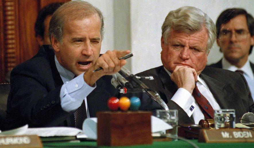 In this Oct. 12, 1991, photo, then-Senate Judiciary Committee Chairman Joe Biden, Delaware Democrat, points angrily at Clarence Thomas during comments at the end of hearings on Justice Thomas' nomination to the U.S. Supreme Court on Capitol Hill. Sen. Edward Kennedy, Massachusetts Democrat, is seated next to Mr. Biden. (AP Photo/Greg Gibson, File)