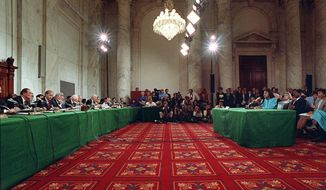 FILE - In this Oct. 11, 1991, file photo,  Anita Hill testifies in the Russell Caucus room on Capitol Hill in Washington where the Senate Judiciary Committee was hearing testimony on the nomination of Clarence Thomas for the Supreme Court. (AP Photo/Greg Gibson, File)