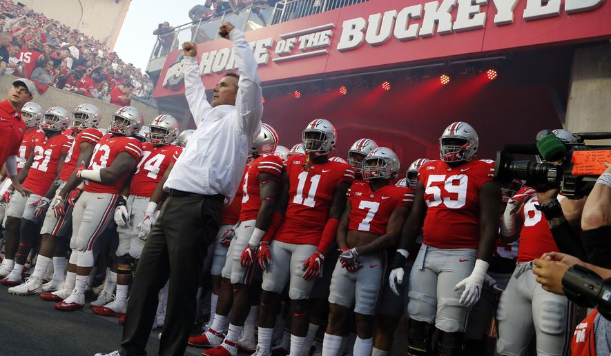 FILE - In this Saturday, Sept. 9, 2017, file photo, Ohio State head coach Urban Meyer leads his team onto the field before an NCAA college football game against Oklahoma in Columbus, Ohio. Meyer will be back on the Ohio State sideline Saturday against Tulane after serving a three-game suspension. He was forced to sit out after the university determined he mismanaged the behavior of former assistant Zach Smith.(AP Photo/Jay LaPrete, File)