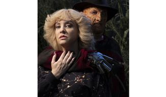 "This image released by ABC shows Wendi McLendon-Covey, left, and Robert Englund in the episode ""Nightmare on Elk Avenue"" on the television show, ""The Goldbergs."" ABC announced Friday, Sept. 21, 2018, that Englund is reprising his role as the ""A Nightmare on Elm Street"" slasher for a Halloween episode of the ABC sitcom that is set in the 1980s. (John Fleenor/ABC via AP)"