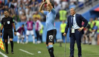 FILE - In this July 6, 2018 file photo, Uruguay head coach Oscar Tabarez watches from the sidelines, the quarterfinal match between Uruguay and France at the 2018 soccer World Cup in the Nizhny Novgorod Stadium, in Nizhny Novgorod, Russia. (AP Photo/Martin Meissner, File)