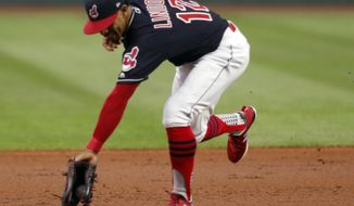 Cleveland Indians' Francisco Lindor fields a ball hit by Chicago White Sox's Omar Narvaez during the first inning of a baseball game, Thursday, Sept. 20, 2018, in Cleveland. Narvaez was out at first. (AP Photo/Tom E. Puskar)