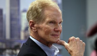 FILE- In this Aug. 6, 2018, file photo Sen. Bill Nelson, D-Fla.l istens during a roundtable discussion with education leaders from South Florida at the United Teachers of Dade headquarters in Miami.  Florida's 2018 midterm election is one of the most important in years. The governor's office and all three Cabinet seats are on the ballot; Republican Gov. Rick Scott is challenging Nelson; several congressional seats will be competitive; and Floridians will vote on several proposed constitutional amendments.  (AP Photo/Lynne Sladky, File)