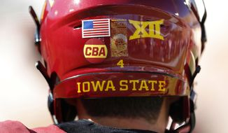 "Iowa State quarterback Zeb Noland wears a ""CBA"" sticker on his helmet to honor slain student Celia Barquin Arozamena before an NCAA college football game against Akron, Saturday, Sept. 22, 2018, in Ames, Iowa. Barquin, who was the 2018 Big 12 women's golf champion and Iowa State Female Athlete of the Year, was found Monday morning in a pond at a golf course near the Iowa State campus. (AP Photo/Charlie Neibergall)"