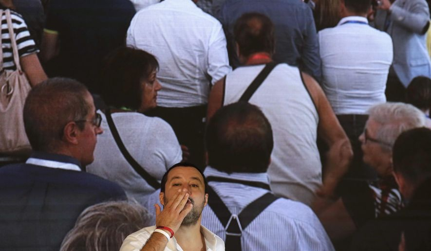 Italian Interior Minister Matteo Salvini blows a kiss to a supporter as he arrives at the Brothers of Italy political meeting in Rome, Saturday, Sept. 22, 2018. (AP Photo/Alessandra Tarantino)