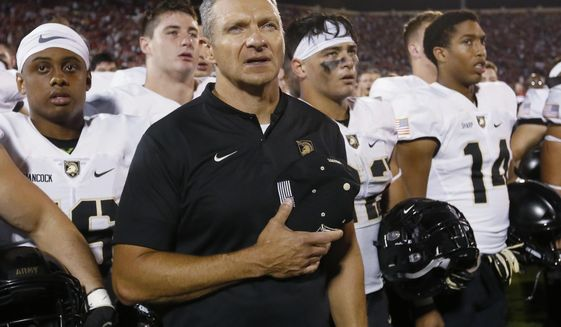 Army head coach Jeff Monken stands with his team after of an NCAA college football game against Oklahoma in Norman, Okla., Saturday, Sept. 22, 2018. Oklahoma won 28-21 in overtime. (AP Photo/Sue Ogrocki)
