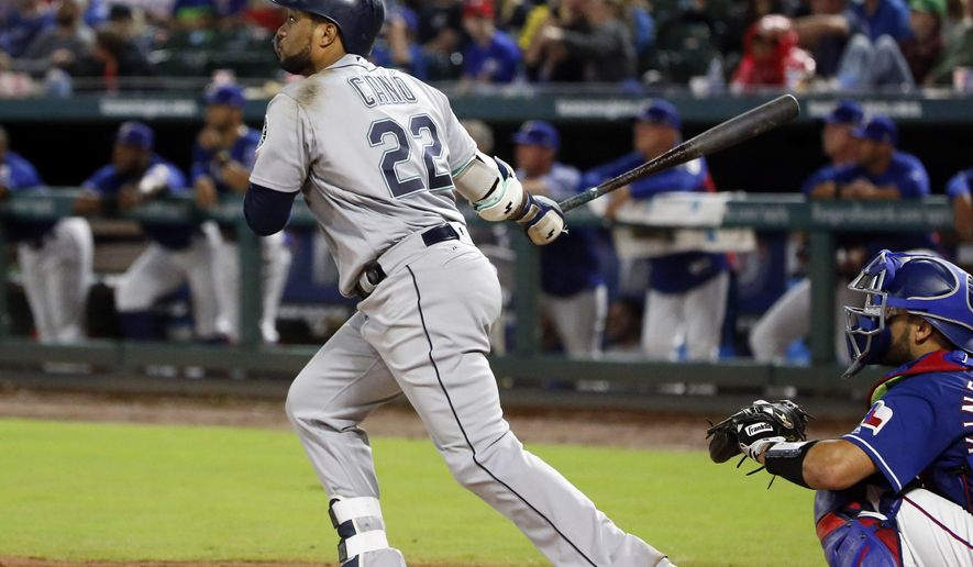 Seattle Mariners' Robinson Cano (22) watches the flight of his three-run home run against the Texas Rangers during the fifth inning of a baseball game Saturday, Sept. 22, 2018, in Arlington, Texas. (AP Photo/Michael Ainsworth)