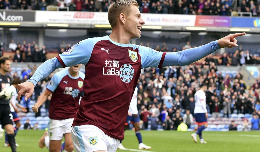 Burnley's Matej Vydra celebrates scoring his side's first goal of the game, during the English Premier League soccer match between Burnley and Bournemouth at Turf Moor, in  Burnley, England, Saturday, Sept. 22, 2018. (Anthony Devlin/PA via AP)