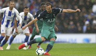 Tottenham Hotspur's Harry Kane scores his side's first goal of the game from the penalty spot against Brighton & Hove Albion during the English Premier League soccer match at the AMEX Stadium, Brighton, England, Saturday Sept. 22, 2018. (Steven Paston/PA via AP)