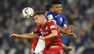 Bayern's Leon Goretzka, left, and Schalke's Weston McKennie, right, challenge for the ball during the German Bundesliga soccer match between FC Schalke 04 and Bayern Munich in Gelsenkirchen, Germany, Saturday, Sept. 22, 2018. (AP Photo/Martin Meissner)