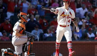 St. Louis Cardinals' Tyler O'Neill, right, celebrates after hitting a walk-off home to defeat the San Francisco Giants 5-4 as catcher Nick Hundley kneels at the plate in the 10th inning of a baseball game Saturday, Sept. 22, 2018, in St. Louis. (AP Photo/Jeff Roberson)