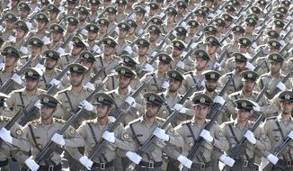 Iranian armed forces members march in a military parade marking the 38th anniversary of Iraq's 1980 invasion of Iran, in front of the shrine of the late revolutionary founder, Ayatollah Khomeini, outside Tehran, Iran, Saturday, Sept. 22, 2018. Gunmen attacked the military parade, killing at least eight members of the elite Revolutionary Guard and wounding 20 others, state media said. (AP Photo/Ebrahim Noroozi)