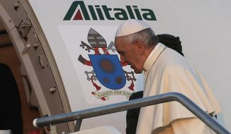 Pope Francis boards his airplane on the occasion of his trip to Lithuania, Latvia and Estonia at Rome's Fiumicino International Airport, Saturday, Sept.22, 2018. Pope Francis heads to Europe's northeastern peripheries this weekend to celebrate the faith in three Baltic countries amid renewed alarm about Russia's intentions in the region it twice occupied. (AP Photo/Alessandra Tarantino)