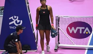 Naomi Osaka of Japan walks on the court to play against Italy's Camila Giorgi during the semifinal match of the Pan Pacific Open women's tennis tournament in Tokyo Saturday, Sept. 22, 2018. (AP Photo/Eugene Hoshiko)