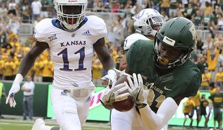 Baylor wide receiver Tyquan Thornton (81) catches a pass for a touchdown against Kansas safety Mike Lee (11) during the first half of an NCAA college football game, Saturday, Sept. 22, 2018, in Waco, Texas. (Jerry Larson/Waco Tribune-Herald via AP)