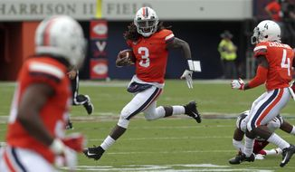 Virginia quarterback Bryce Perkins (3) runs with the ball against Louisville during the first half of an NCAA college football game Saturday, Sept. 22, 2018, in Charlottesville, Va. (Andrew Shurtleff/The Daily Progress via AP)