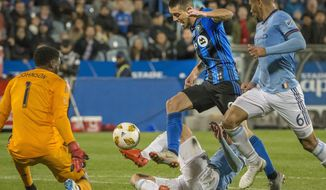 Montreal Impact's Alejandro Silva charges to the goal through the New York City FC defense during the second half of an MLS soccer match Saturday, Sept. 22, 2018, in Montreal. (Peter McCabe/The Canadian Press via AP)