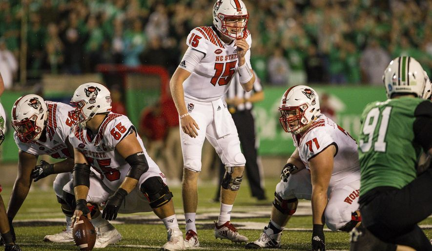 North Carolina State quarterback Ryan Finley (15) calls out instructions to teammates during an NCAA college football game against Marshall, Saturday, Sept. 22, 2018, at Joan C. Edwards Stadium in Huntington, W.Va. (Sholten Singer/The Herald-Dispatch via AP)