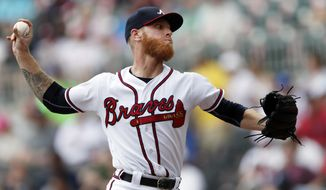 Atlanta Braves starting pitcher Mike Foltynewicz works against the Philadelphia Phillies in the first inning of a baseball game Saturday, Sept. 22, 2018, in Atlanta. (AP Photo/John Bazemore)