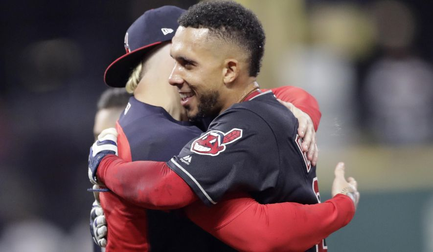 Cleveland Indians' Michael Brantley, right, hugs a teammate after hitting a winning RBI-single in the 11th inning of a baseball game against the Boston Red Sox, Saturday, Sept. 22, 2018, in Cleveland. (AP Photo/Tony Dejak)