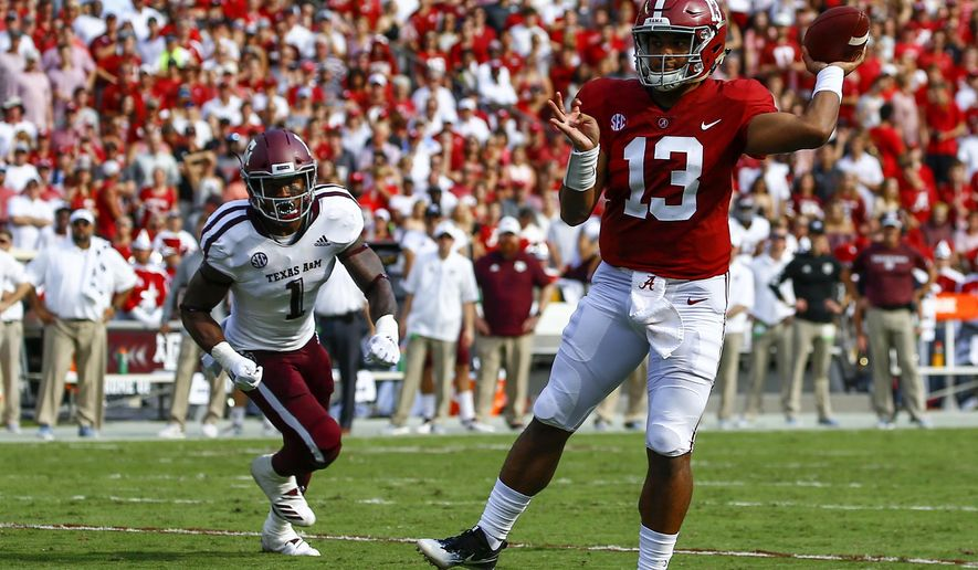 Alabama quarterback Tua Tagovailoa (13) throws a touchdown pass against Texas A&M during the first half of an NCAA college football game, Saturday, Sept. 22, 2018, in Tuscaloosa, Ala. (AP Photo/Butch Dill)