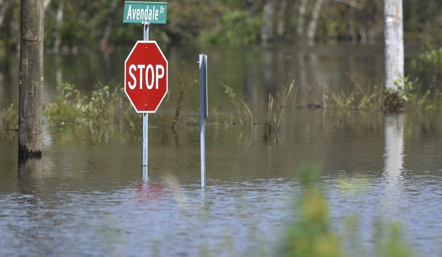 A road is flooded from Hurricane Florence in the Avondale community in Hampstead, N.C., Friday, Sept. 21, 2018. (Matt Born /The Star-News via AP)