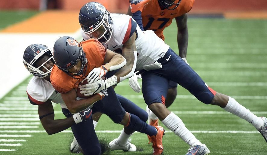 Syracuse wide receiver Sean Riley is tackled by Connecticut defenders during an NCAA college football game Saturday, Sept. 22, 2018, in Syracuse, N.Y. (Dennis Nett/The Post-Standard via AP)