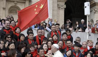 "FILE - In this April 18, 2018 file photo, Pope Francis meets a group of faithful from China at the end of his weekly general audience in St. Peter's Square, at the Vatican. On Saturday, Sept. 22, 2018, the Vatican announced it had signed a ""provisional agreement"" with China on the appointment of bishops, a breakthrough on an issue that for decades fueled tensions between the Holy See and Beijing and thwarted efforts toward diplomatic relations. (AP Photo/Gregorio Borgia, file)"