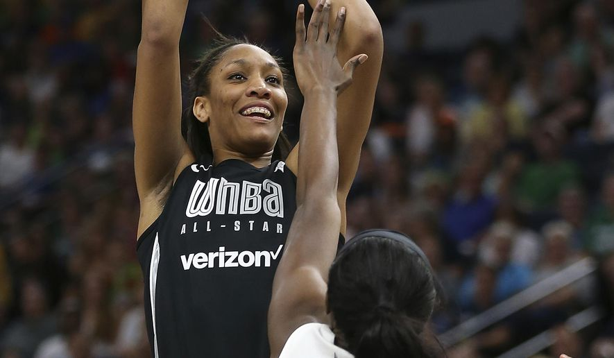 In this July 28, 2018, file photo, Team Delle Donne's A'ja Wilson, left, shoots the ball against the Team Candace Parker's Chiney Ogwumike, right, during the first half of the WNBA All-Star basketball game in Minneapolis. (AP Photo/Stacy Bengs, File)