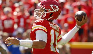 Kansas City Chiefs quarterback Patrick Mahomes (15) prepares to throw during the second half of an NFL football game against the San Francisco 49ers in Kansas City, Mo., Sunday, Sept. 23, 2018. (AP Photo/Charlie Riedel)