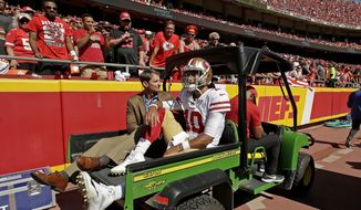 San Francisco 49ers quarterback Jimmy Garoppolo (10) is carted off the field after being injured during the second half of an NFL football game against the Kansas City Chiefs, Sunday, Sept. 23, 2018, in Kansas City, Mo. (AP Photo/Charlie Riedel) **FILE**
