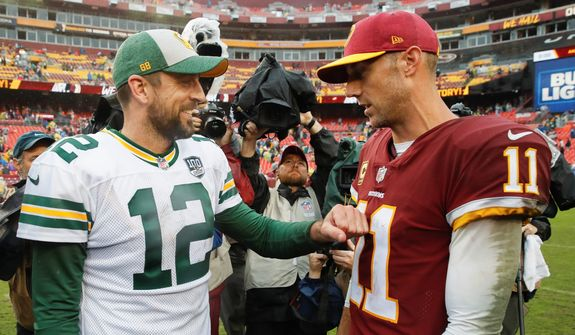 Redskins quarterback Alex Smith was steady in Washington's victory on Sunday, while friend and Green Bay Packers quarterback Aaron Rodgers was hampered by an injury. (ASSOCIATED PRESS)