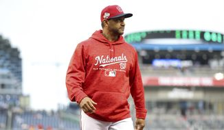 Washington Nationals manager Dave Martinez walks to the dugout after a pitching charge in the fifth inning of a baseball game against the New York Mets at Nationals Park, Sunday, Sept. 23, 2018, in Washington. The Mets won 8-6. (AP Photo/Andrew Harnik)